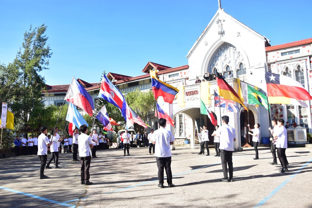 Seminarians parade the flags of 22 countries where the Order maintains missionary presence during the welcome program of the 13th RAYNS.