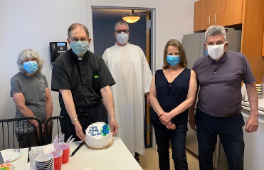 Undercover Birthday: Fr. John Gruben celebrates his birthday with some of the parish staff of Sacred  </br> Heart Church (l to r): Janis Batewell (director of Religious Ed), Fr. John, Fr. Michael Rafferty (pastor), </br> Patt Chester (parish secretary) and Henry Antonucci (sacristan)